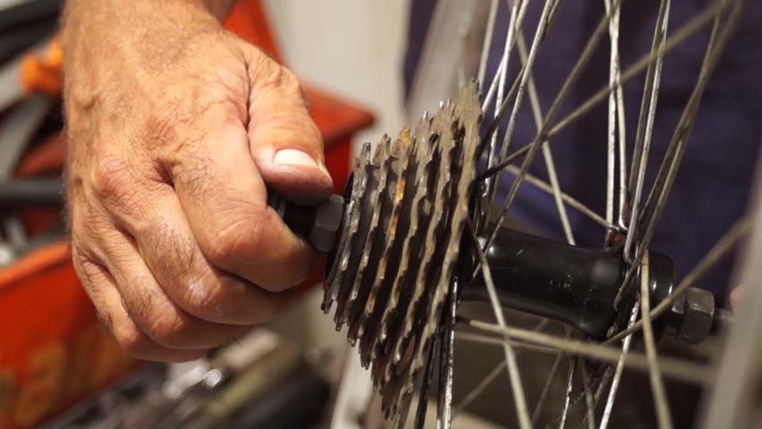 Bicycle repairer installs freewheel | Shutterstock HD Video #1027526957