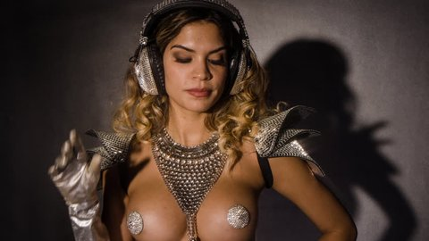 amazing woman dances in a sparkling silver costume