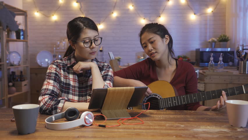 Young Asian Girls Playing Guitar Stock Footage Video (100% Royalty-free)  1027590137   Shutterstock