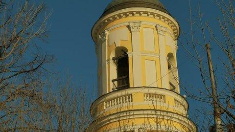 "Belfry of Church of the Mother Of God ""Joy of All who sorrow"" (Saviour of Transfiguration) on Bolshaya Ordynka street, Moscow. Russian Orthodox church of the XVI century. Tilt up shot."