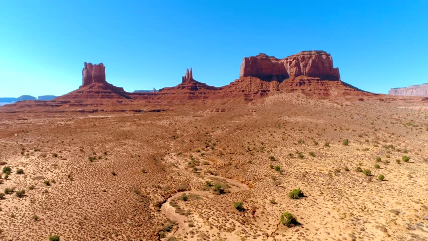 4K drone footage of the classic American West landscape. Stunning location within the Navajo Nation on the border of Arizona and Utah.