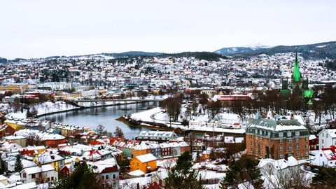 Trondheim, Norway. Aerial view of the city center in winter in Trondheim, Norway with snow. Time-lapse of river and historical colorful buildings, zoom in