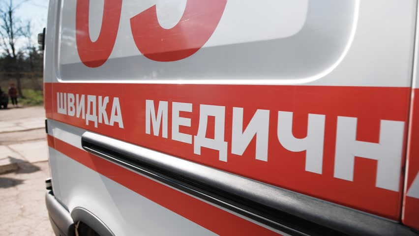 """Ambulance car that is used in Ukraine. On the side of the car there is an inscription in the Ukrainian language - """"emergency medical care"""", above you can see the number of the shortened telephone"""