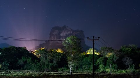 Night sky time lapse over Sigiriya rock fortress in Sri Lanka