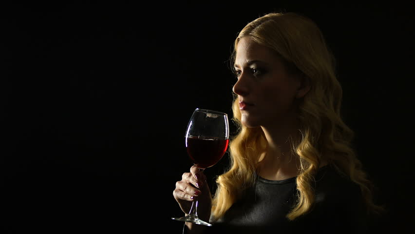 Sexy woman drinking glass of wine isolated on black background, night party | Shutterstock HD Video #1027729427