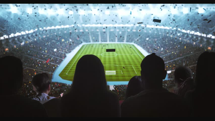 Group of cheering fans watch a sport championship on stadium. Their team wins and everybody are celebrating this event. People are dressed in casual clothes. Colorful confetti fly in the air. | Shutterstock HD Video #1027762937
