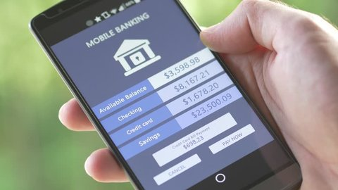 Making mobile baking transactions with a smartphone. In the U.S 56 million people, consider themselves primarily using a mobile device to access their checking accounts.