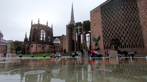 Coventry, West Midlands, UK - April 7, 2019: Low perspective view of Coventry cathedral through a fountain water feature in university square