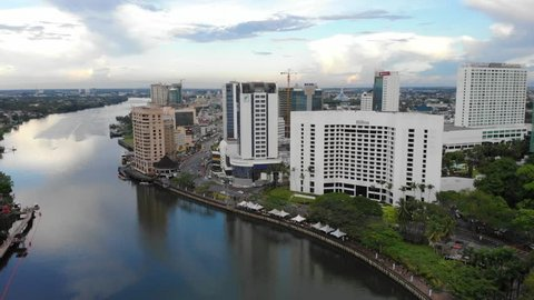 KUCHING, SARAWAK - APRIL 2019. Cinematic shot of Hilton Hotel and Riverside Majestic Hotel, Kuching. These hotels are located at Jalan Main Bazaar and are among the largest hotel in kuching