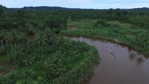 travelling with boat in mentawai river, west sumatra, indonesia