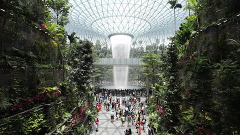 Singapore,Singapore - April 20, 2019 : Timelapse of Jewel Changi Airport connecting to Terminal 1 Arrival and Terminal 2,3 through linked bridges