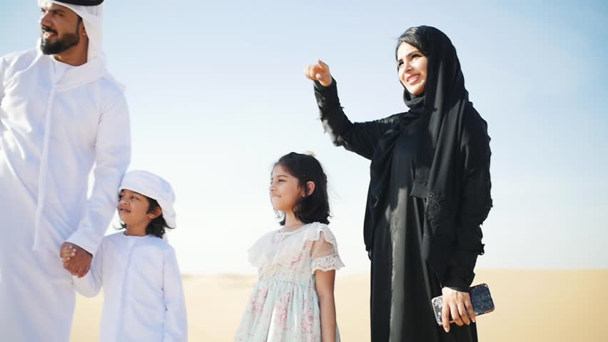 Happy muslim family spending weekend making safari in the dubai desert. Parents and kids having good time. lifestyle moments | Shutterstock HD Video #1027983677