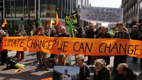 LONDON, circa 2019 - Extinction Rebellion demonstrators occupy Oxford Circus in London, UK to raise awareness to the danger of Climate Change