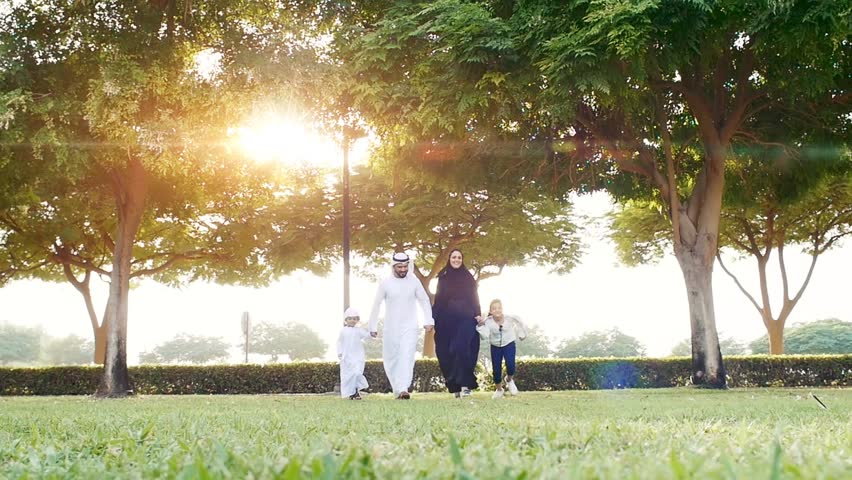 Happy family in Dubai . Artistic digital sun flare in the background | Shutterstock HD Video #1028068457