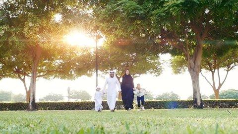 Happy family in Dubai . Artistic digital sun flare in the background