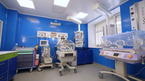 Neonatal unit with a baby lying in the incubator