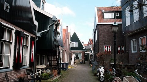 Typical small Dutch houses facades in Volendam. Beautiful architecture Volendam Netherlands 03.18.2019