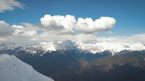Aerial view snow covered mountains. Travel concept and winter vacation on white snowy mountains.