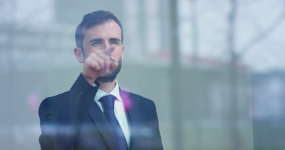 Slow motion of handsome businessman using futuristic augmented reality hologram for viewing finance and economic trends. | Shutterstock HD Video #1028140607