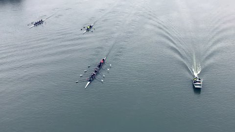 Beautiful team rowing with a coach support, even dirty water can't hinder the achievement of the goal