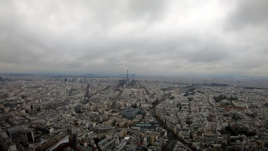 4K Timelapse aerial view of Eiffel Tower and Paris city. Elevated view of cityscape with tour Eiffel in cloudy and raining day of winter at France. Famous touristic places and popular destinations-Dan | Shutterstock HD Video #1028272007