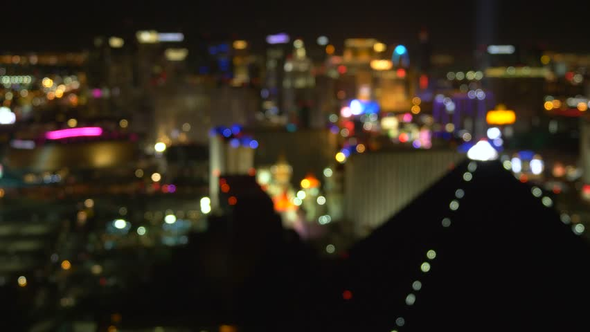 Night view of Las Vegas from the hotel window. Out Of Focus Vegas Strip Casino Lights Wide View. Las Vegas strip at night. Las Vegas Strip blurred background.
