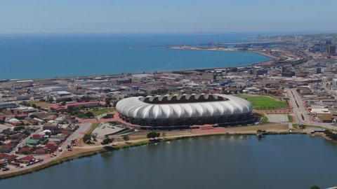 Port Elizabeth, South Africa - circa 2010s: Aerial view of Port Elizabeth city skyline, beautiful sunny summer day. Nelson Mandela Bay Stadium, North End Lake foreground, CBD and Harbour background