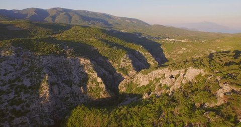 Aerial: The mountains of the Greek island Samos during sunset.
