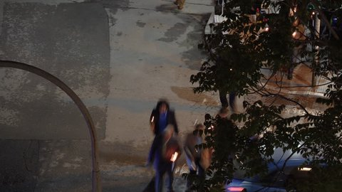 Elevated view of blurred motion people holding candles at night on Resurrection Sunday, called Pascha. Unidentified crowd walking on the street during Greek Orthodox Easter in Thessaloniki, Greece.