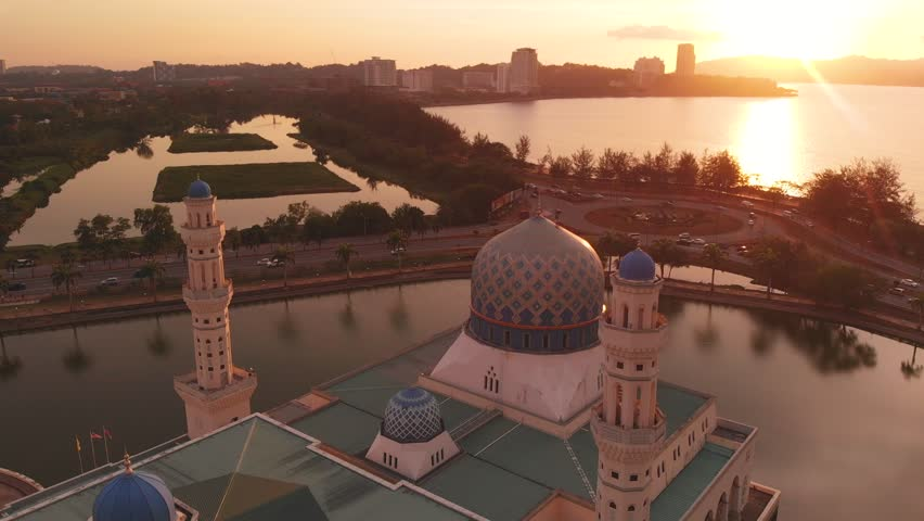 Aerial view of during sunset of Beautiful Mosque And The Most Famous Tourist Spot in Kota Kinabalu, Sabah, Malaysia   | Shutterstock HD Video #1028579777