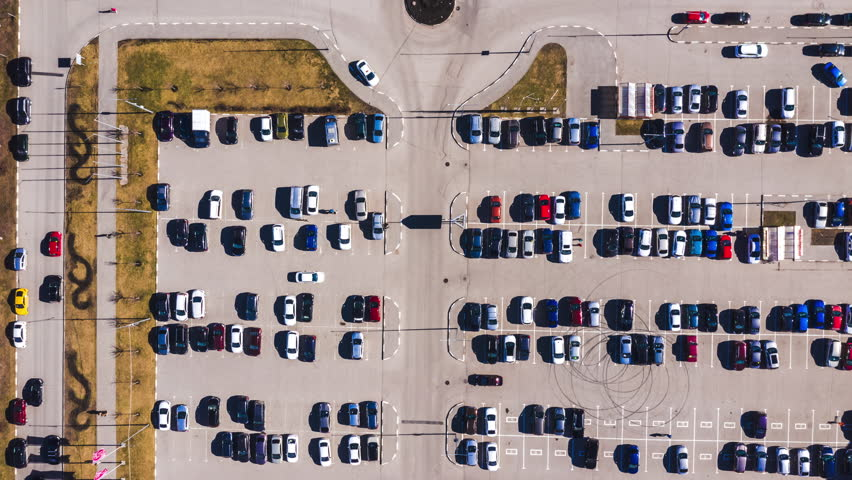 Aerial top-down view of parking lot near city mall. | Shutterstock HD Video #1028630807