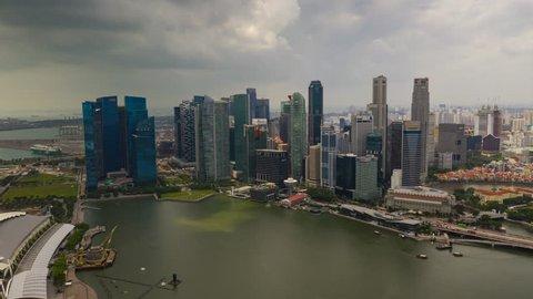 SINGAPORE - FEBRUARY 4 2019: day time flight over singapore city downtown marina bay aerial panorama 4k timelapse circa february 4 2019 singapore.