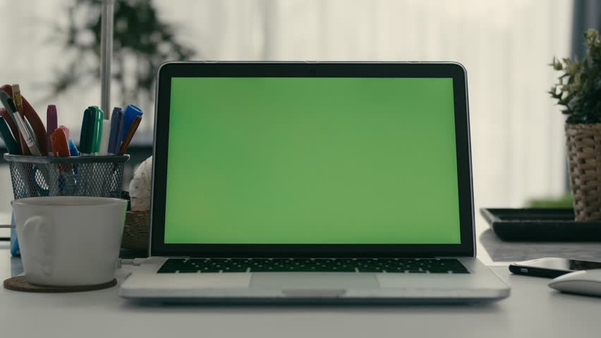 Desk working at home on with laptop green screen #1028646647