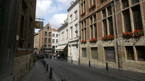 Belgium, Brussels - October, 2016: Bollards on the sidewalks of a narrow street