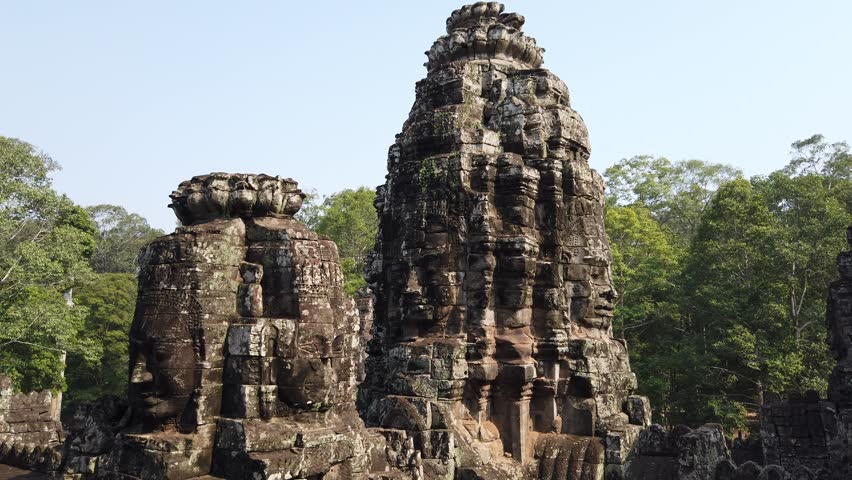 Huge stone faces on the towers of the ancient temple. Bayon. Angkor. Cambodia #1028721167