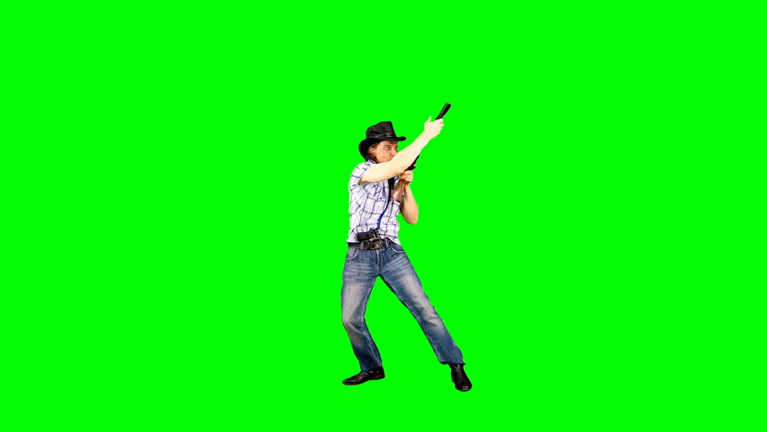 Cool confident cowboy in a hat charges his carbine, takes aim and shoots. #1028738207