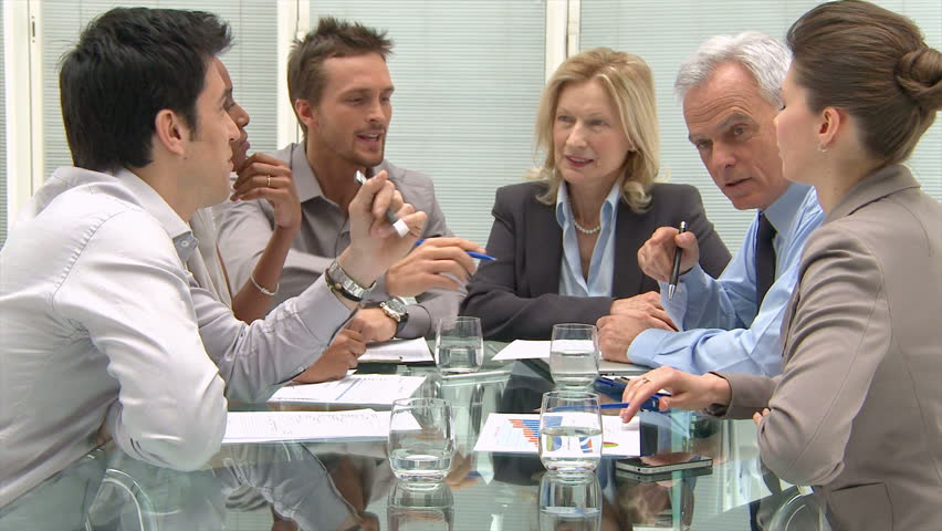 Group Of Coworkers Discussing In Conference Room. Business meeting on a modern office. Business teamwork in a meeting room for a new deal. Colleagues working together a new financial budget. | Shutterstock HD Video #10287626
