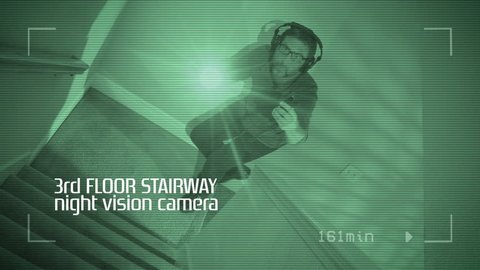 Ghost hunter investigating paranormal activity in haunted house, night vision video playback with subtitles and screen glitch