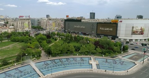 Footage of Unirii Boulevard Fountains in Bucharest with House of the People in the background.