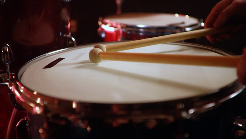 Drummer, jazz lesson , percussion drumsticks , drumroll on a snare  a rehearsal studio on a red drums , low key, close-up | Shutterstock HD Video #1028916287