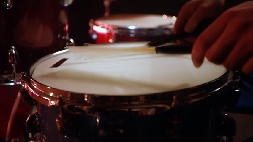 Drummer, jazz lesson drumroll, classic grip of brushes drumsticks on a snare  a rehearsal studio on a red drums , low key, close-up | Shutterstock HD Video #1028916317