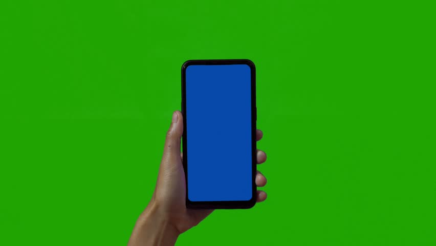 Phone in the hand close up isolated at green background. Phone screen is blue chroma key, background chroma key green screen. Footage for mobile ads, app promo. | Shutterstock HD Video #1028986937