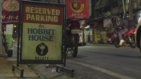 MANILA, PHILIPPINES - CIRCA JANUARY 2017: Manila bar The Hobbit house entry sign