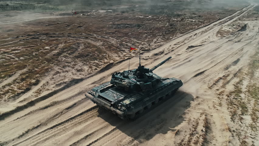Military Army Tank Shooting Aerial View. Back View Armoured Combat Fighting Vechicle Shooting in Sand. War Battle Technology Concept. Drone Shot Footage 4K (UHD) | Shutterstock HD Video #1029080957