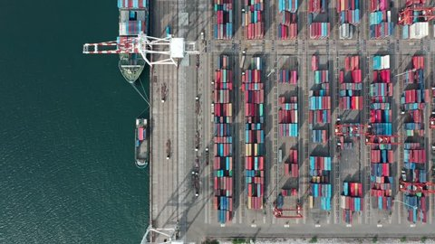Logistic business or transport concept : Aerial top down view over import export port of Thailand with many stacks of cargo container rows and big cranes.