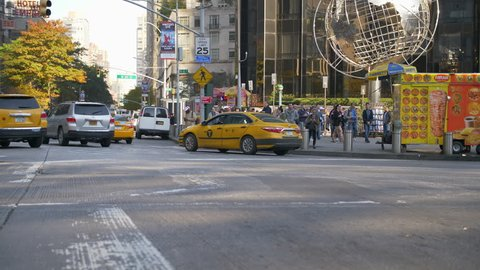 NEW YORK CITY, USA - 01/03/2019: Armillary Sphere At Trump International Hotel And Tower In Columbus Circle. New York city traffic at rush hour. classic yellow Taxi Cab. Autumn Day.
