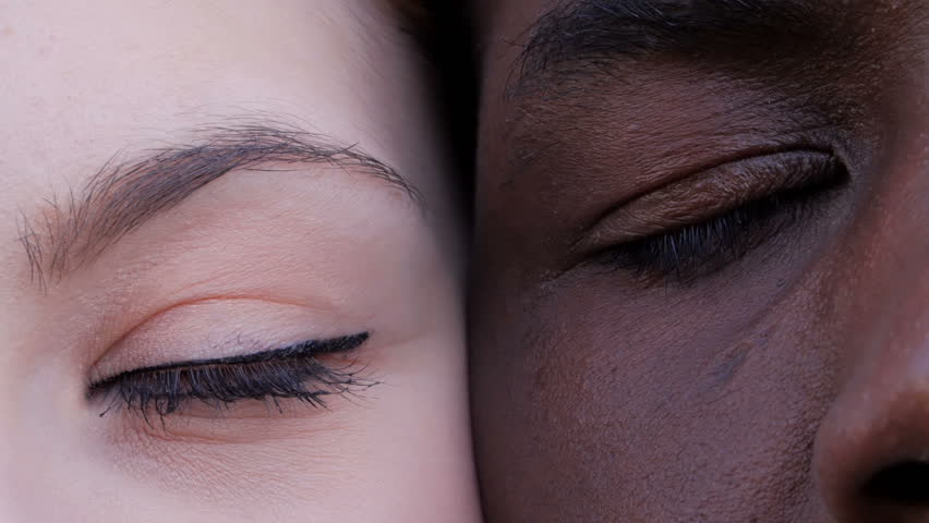 Black man and white woman's eyes opening.Interracial race love concept-macro | Shutterstock HD Video #1029159227