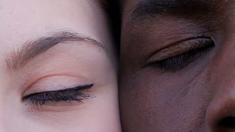 black man and white woman's eyes opening.Interracial race love concept-macro