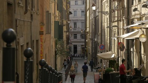 Italy, Rome - September, 2016: People walking on a narrow street in Rome.