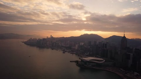 Aerial View drone 4k footage Of Modern Skyscrapers In Hong Kong City. buildings in Hong Kong city on sunrise.